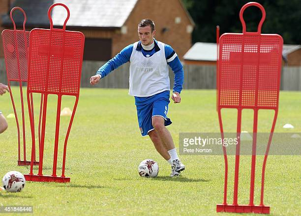 Lee Collins of Northampton Town moves with the ball during a training session at Moulton College on July 8 2014 in Northampton United Kingdom