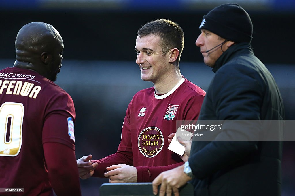 Lee Collins of Northampton Town prepares to enter the pitch as a substitute for team mate Adebayo Akinfenwa during the npower League Two match between Northampton Town and Rochdale at Sixfields Stadium on February 9, 2013 in Northampton, England.