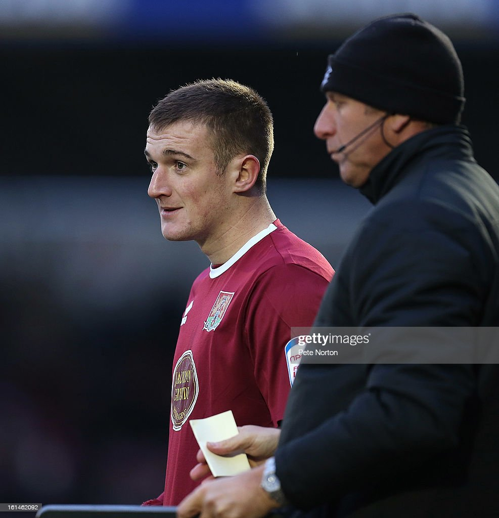Lee Collins of Northampton Town prepares to enter the pitch as a substitute during the npower League Two match between Northampton Town and Rochdale at Sixfields Stadium on February 9, 2013 in Northampton, England.