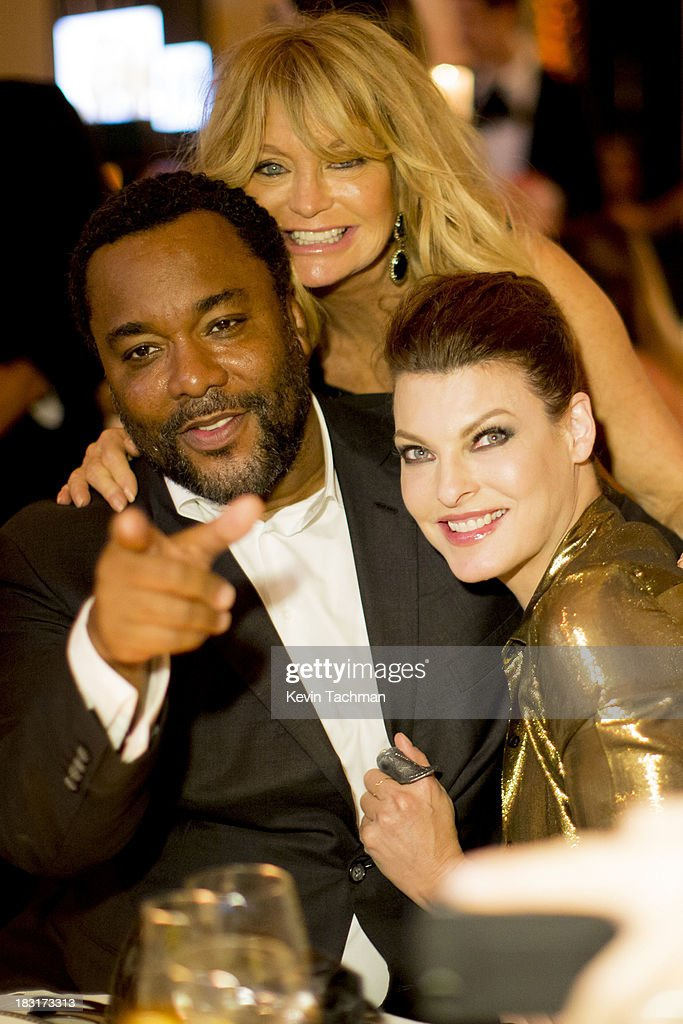 <a gi-track='captionPersonalityLinkClicked' href=/galleries/search?phrase=Lee+Daniels&family=editorial&specificpeople=209078 ng-click='$event.stopPropagation()'>Lee Daniels</a>, <a gi-track='captionPersonalityLinkClicked' href=/galleries/search?phrase=Goldie+Hawn&family=editorial&specificpeople=171422 ng-click='$event.stopPropagation()'>Goldie Hawn</a>, center, and <a gi-track='captionPersonalityLinkClicked' href=/galleries/search?phrase=Linda+Evangelista&family=editorial&specificpeople=203121 ng-click='$event.stopPropagation()'>Linda Evangelista</a> attend the amfAR Inspiration Gala Rio on October 4, 2013 in Rio de Janeiro, Brazil.