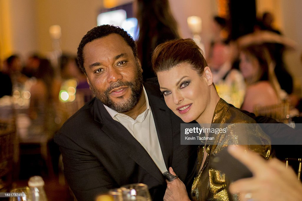 <a gi-track='captionPersonalityLinkClicked' href=/galleries/search?phrase=Lee+Daniels&family=editorial&specificpeople=209078 ng-click='$event.stopPropagation()'>Lee Daniels</a>,left, and <a gi-track='captionPersonalityLinkClicked' href=/galleries/search?phrase=Linda+Evangelista&family=editorial&specificpeople=203121 ng-click='$event.stopPropagation()'>Linda Evangelista</a> attend the amfAR Inspiration Gala Rio on October 4, 2013 in Rio de Janeiro, Brazil.