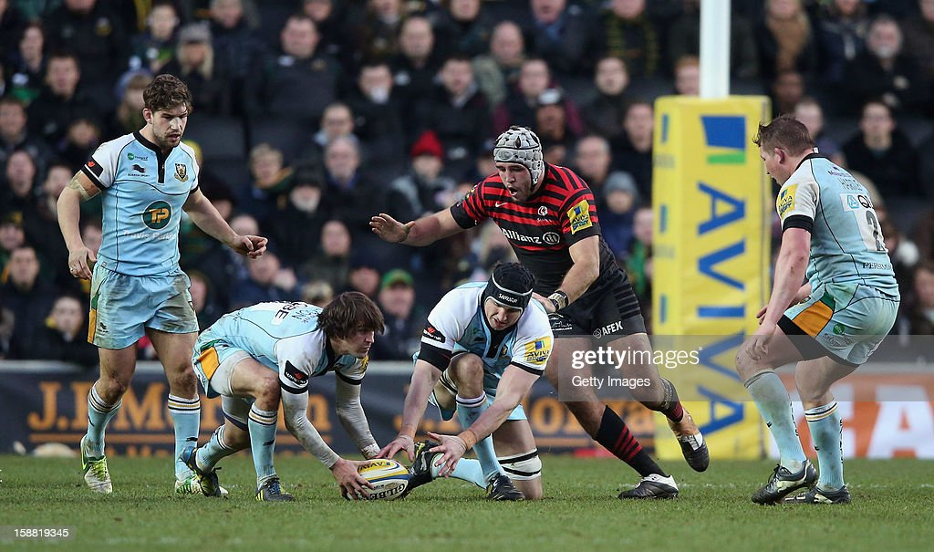 Lee Dickson and Mark Sorenson of Northampton gather the loose ball during the Aviva Premiership match between Saracens and Northampton Saints at StadiumMK on December 0, 2012 in Milton Keynes, England.