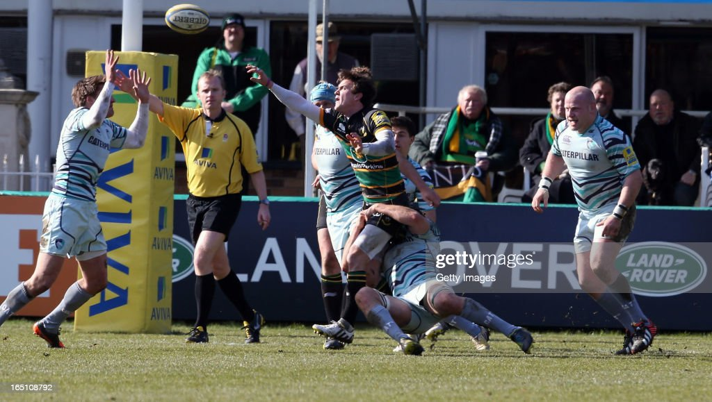 Lee Dickson of Northampton reaches for the ball during the Aviva Premiership match between Northampton Saints and Leicester Tigers at Franklin's Gardens on March 30, 2013 in Northampton, England.