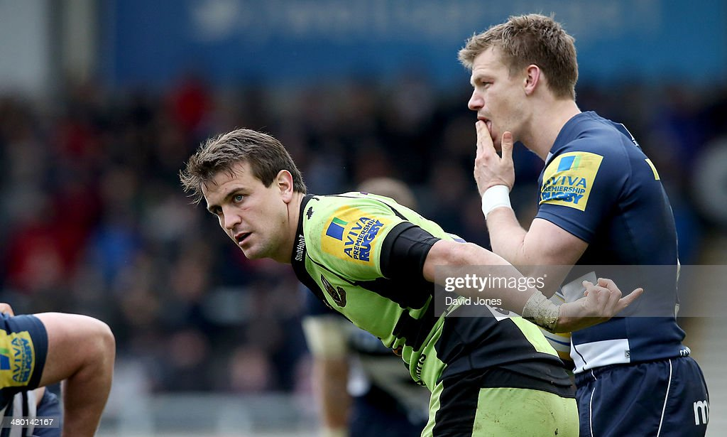 Lee Dickson of Northampton Saints and Dwayne Peel of Sale Sharks during the Aviva Premiership match between Sale Sharks and Northampton Saints at A J Bell Stadium on March 22, 2014 in Salford, England