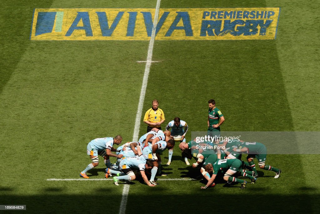 Lee Dickson of Northampton Saints feeds the ball into a scrum watched by referee Wayne Barnes and Ben Youngs of Leicester Tigers during the Aviva Premiership Final between Leicester Tigers and Northampton Saints at Twickenham Stadium on May 25, 2013 in London, England.