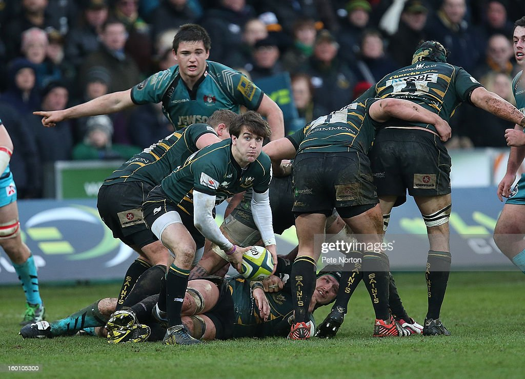 Lee Dickson of Northampton Saints looks to play the ball during the LV=Cup match between Northampton Saints and Gloucester at Franklin's Gardens on January 26, 2013 in Northampton, England.