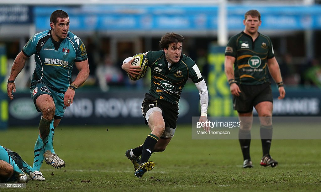 Lee Dickson of Northampton Saints moves forward with the ball during the LV=Cup match between Northampton Saints and Gloucester at Franklin's Gardens on January 26, 2013 in Northampton, England.
