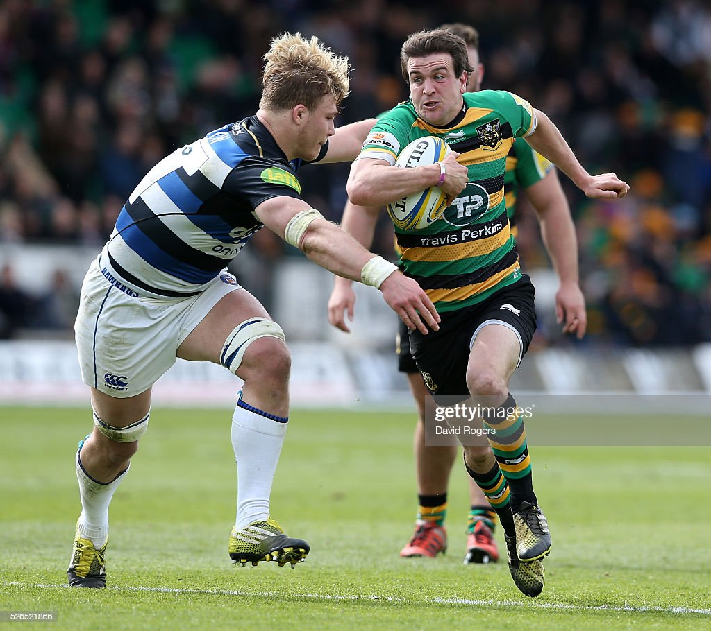 Lee Dickson of Northampton takes on David Denton during the Aviva Premiership match between Northampton Saints and Bath at Franklin's Gardens on April 30, 2016 in Northampton, England.