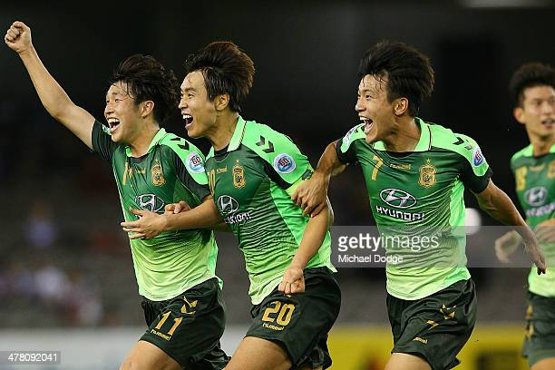 Lee Dong Gook of Joenbuk celebrates his second goal with Seunggi and Han Kyo Won during the AFC Asian Champions League match between the Melbourne...