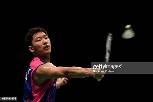 Lee Dong Keun of Korea competes against Emil Holst of Denmark during Mens single qualification round match of the BCA Indonesia Open Super Series...