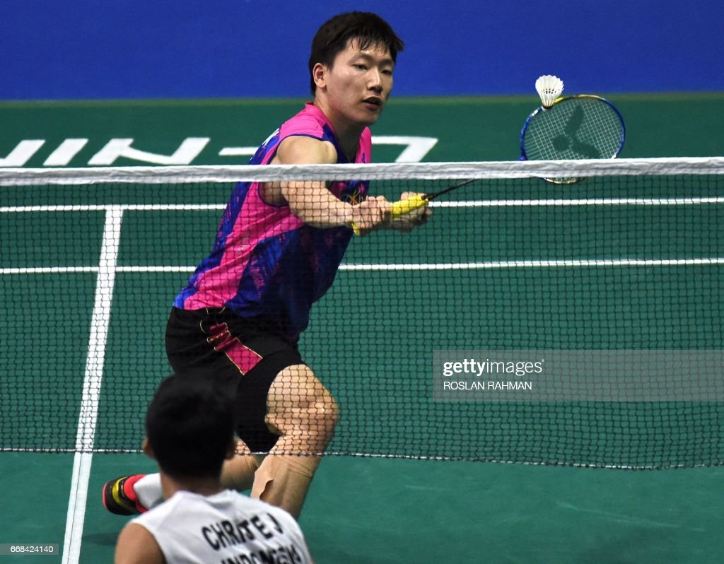 Lee Dong Keun of South Korea plays a shot against Jonatan Christie
