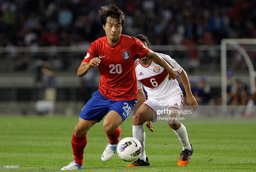 Lee Dong-Gook of South Korea tussles for posession with Mohamed Chaiyhas of Lebanon during the FIFA World Cup Asian Qualifier match between South Korea and Lebanon at Goyang stadium on June 12, 2012 in Goyang, South Korea.