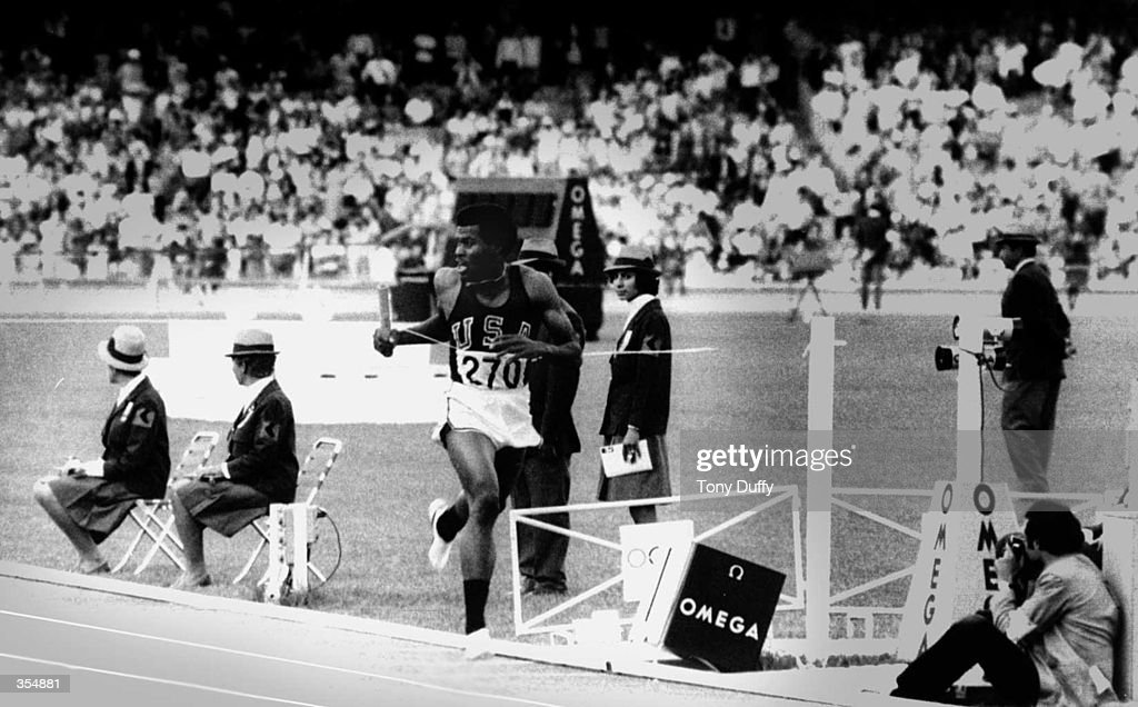 Lee Evans runs the final leg in the 4x400m for the gold medal-winning USA team in the 1968 Olympics in Mexico City. Mandatory Credit: Tony Duffy/ALLSPORT