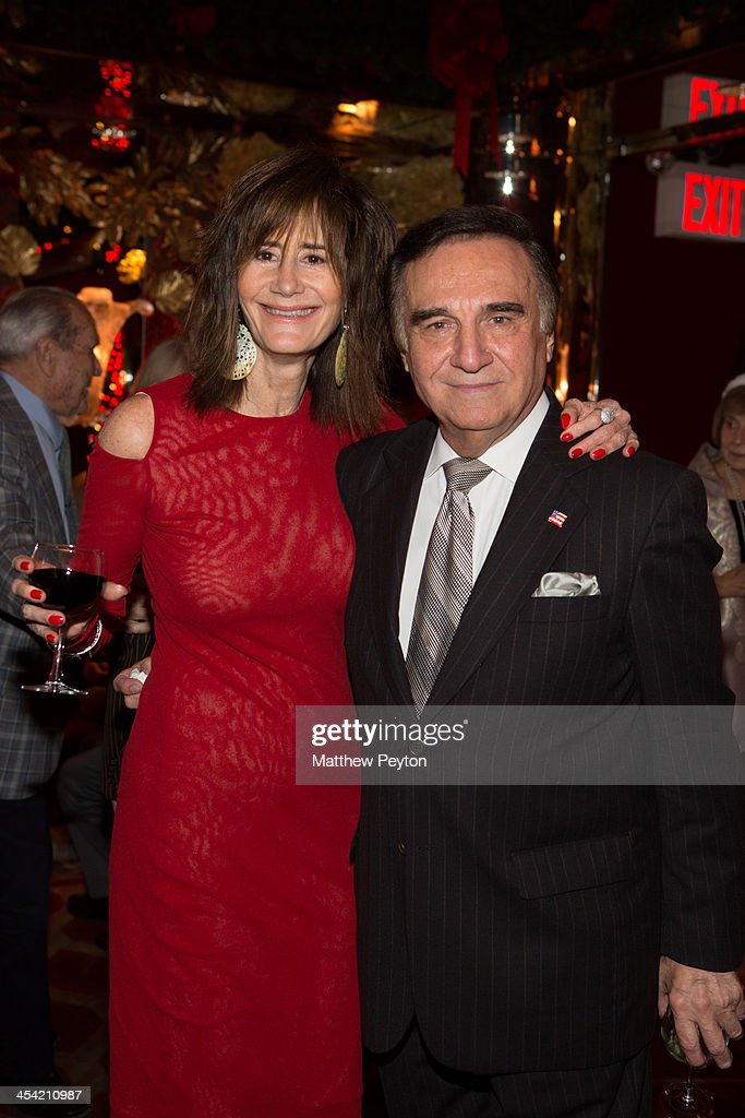 Lee Frye and <a gi-track='captionPersonalityLinkClicked' href=/galleries/search?phrase=Tony+Lo+Bianco&family=editorial&specificpeople=235925 ng-click='$event.stopPropagation()'>Tony Lo Bianco</a> pose together at Stewart F. Lane - aka 'Mr. Broadway' & Bonnie Comley's Holiday Party at The Doubles Club on December 6, 2013 in New York City.