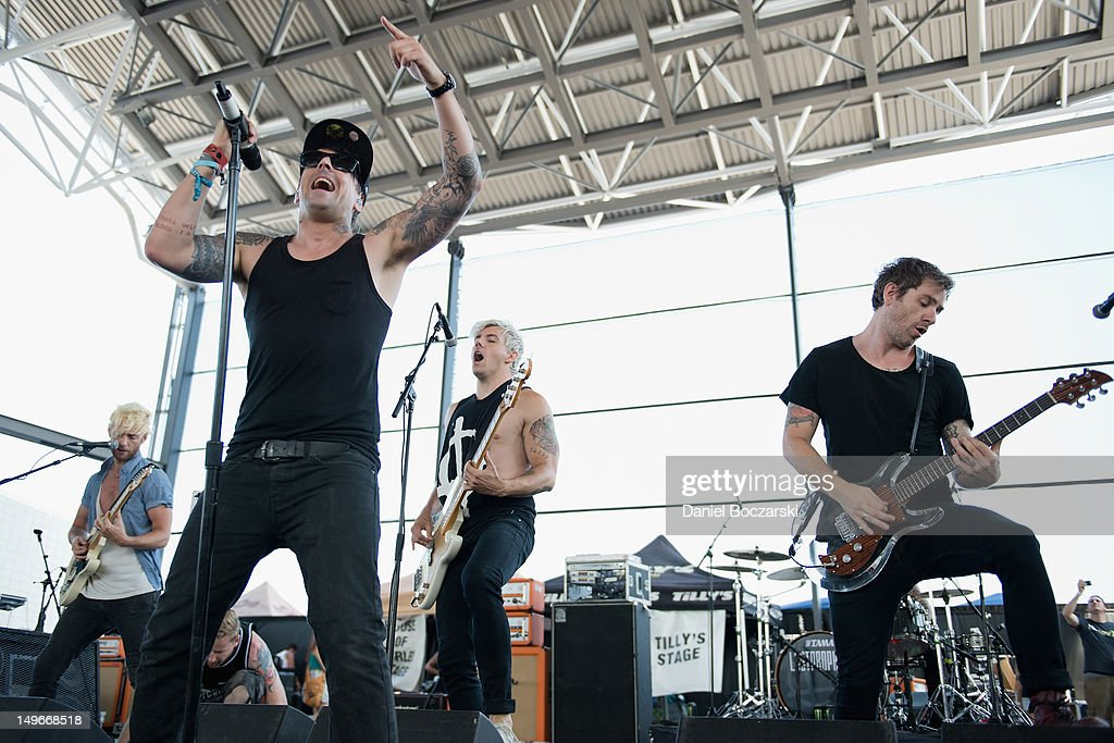 Lee Gaze, Ian Watkins, Stuart Richardson and <a gi-track='captionPersonalityLinkClicked' href=/galleries/search?phrase=Mike+Lewis&family=editorial&specificpeople=763025 ng-click='$event.stopPropagation()'>Mike Lewis</a> of Lostprophets perform on stage during Warped Tour at Marcus Amphitheatre on August 1, 2012 in Milwaukee, United States.