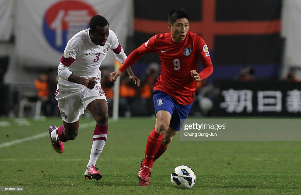 Lee Geun-Ho of South Korea competes with Abdulkarim Hassan of Qatar during the FIFA World Cup Qualifier match between South Korea and Qatar at Olympic Stadium on March 26, 2013 in Seoul, South Korea.