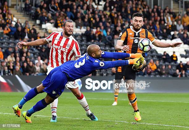 Lee Grant of Stoke City attempts to punch the ball before Robert Snodgrass of Hull City can get to it during the Premier League match between Hull...