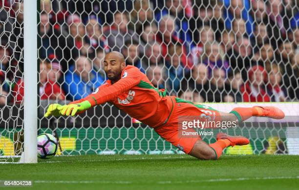Lee Grant of Stoke City fails to stop Willian of Chelsea from scoring their first goal during the Premier League match between Stoke City and Chelsea...
