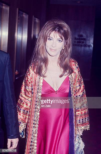 Lee Grant wearing a fuchsia sheath and a brocade evening coat circa 1970 New York