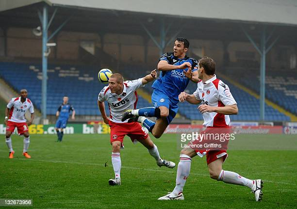 Lee Gregory of Halifax Town rises for a header with MIchael Morrison of Charlton during the FA Cup sponsored by Budweiser First Round match between...