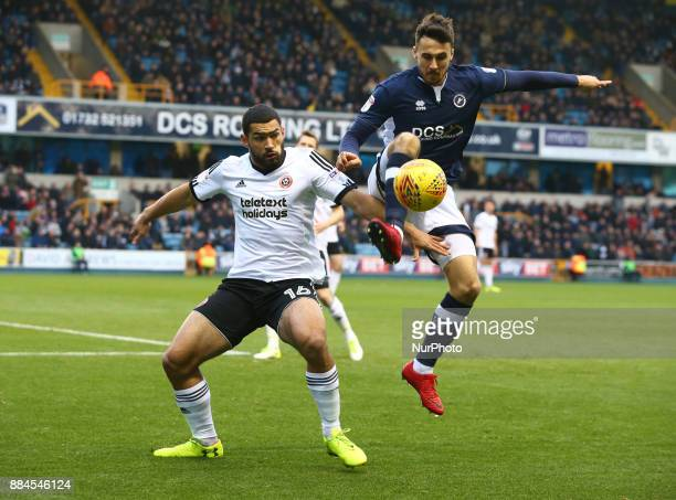 Lee Gregory of Millwall beats Cameron CarterVickers of Sheffield United during Sky Bet Championship match between Millwall against Sheffield United...