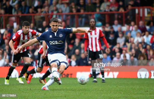 Lee Gregory of Millwall takes a shot from the penalty spot which is saved during the Sky Bet Championship match between Brentford and Millwall at...