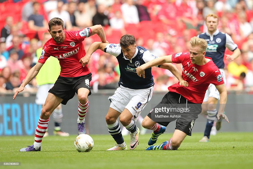 Lee Gregory of Millwall tries to get past Conor Hourihane and Marc Roberts of Barnsley during the Sky Bet League One Play Off Final between Barnsley and Millwall at Wembley Stadium on May 29, 2016 in London, England.