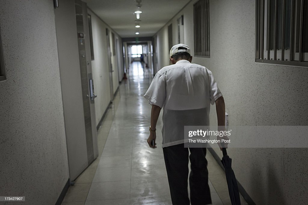 Lee Gyu-il, 80, leaves a care house for POWs and returns home on July 10, 2013 in Seoul, South Korea. Lee escaped from a coal mine in North Korea in 2008.
