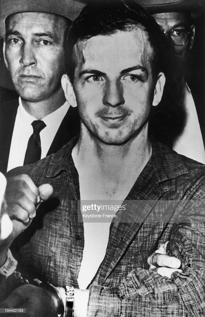 Lee Harvey OSWALD being arrested in Dallas November 22, 1963. Suspected of having shot John Fitzgerald KENNEDY, he too was killed, November 24 by a Dallas nightclub owner, Jack RUBY.