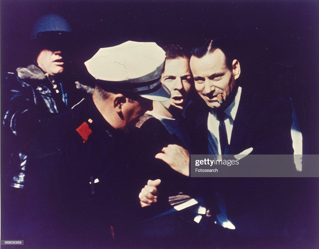 <a gi-track='captionPersonalityLinkClicked' href=/galleries/search?phrase=Lee+Harvey+Oswald&family=editorial&specificpeople=93679 ng-click='$event.stopPropagation()'>Lee Harvey Oswald</a> being escorted by police, circa 1960s. (Photo by Fotosearch/Getty Images).