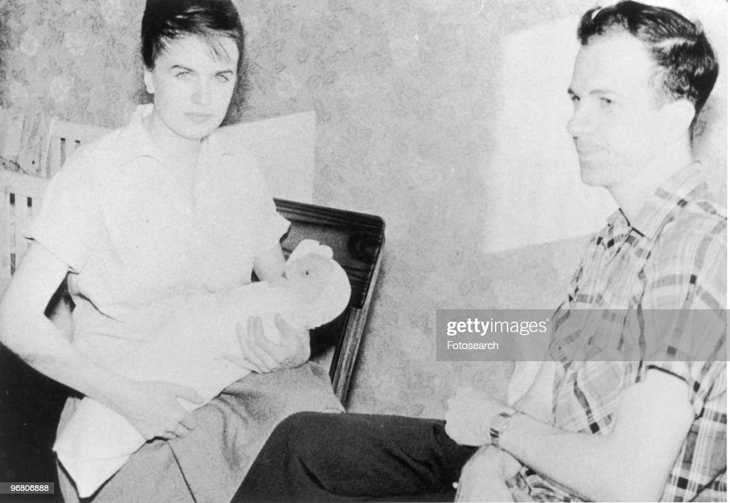 Lee Harvey Oswald sitting with wife Marina Oswald and son June Oswald, circa 1950s. (Photo by Fotosearch/Getty Images).