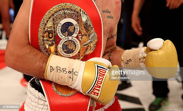 Lee Haskins of Great Britain celebrates with the IBF World Bantamweight title belt after defeating Ryosuke Iwasa of Japan in their Interim IBF World...
