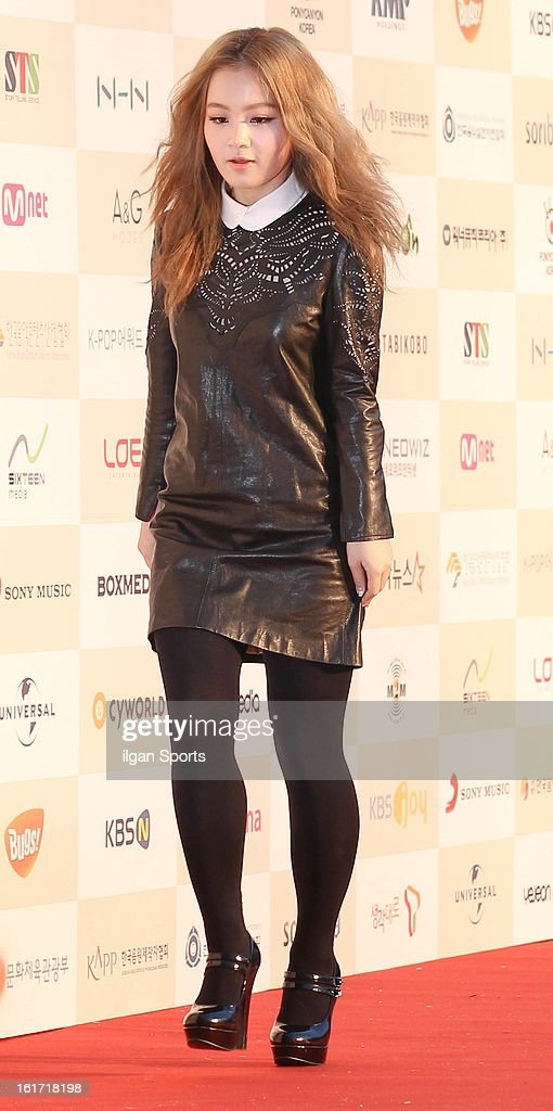Lee HI poses for photographs upon arrival during '2nd Gaonchart K-pop Awards' at Olympic Hall on February 13, 2013 in Seoul, South Korea.
