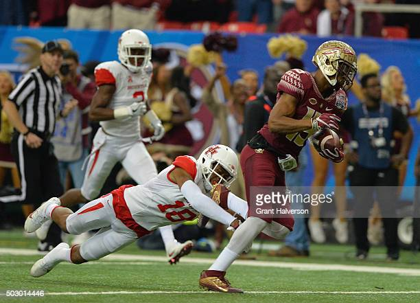 Lee Hightower of the Houston Cougars attempts to tackle Travis Rudolph of the Florida State Seminoles in the third quarter during the ChickfilA Peach...