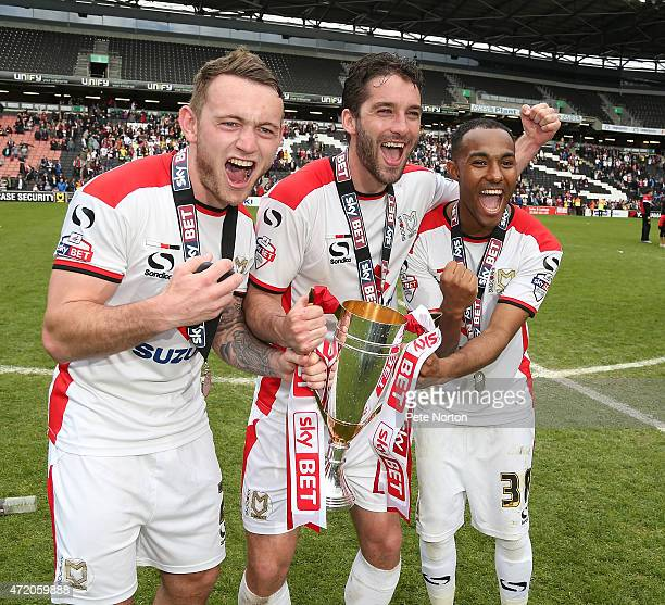 Lee HodsonWill Grigg and Rob Hall of MK Dons celebrate after gaining promotion to the Championship at the end of the Sky Bet League One match between...