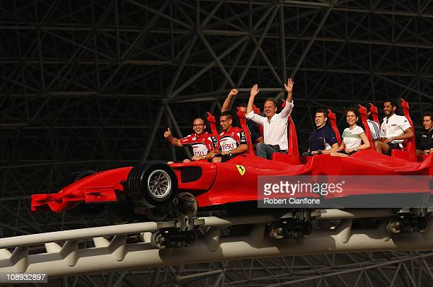 Lee Holdsworth and Michael Caruso of the Fujitsu GRM Racing Team take a ride on a rollercoaster at Ferrari World on February 9 2011 in Abu Dhabi...