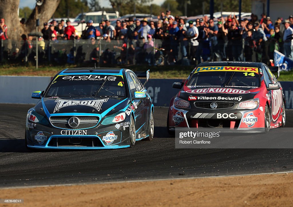 Lee Holdsworth driver of the Erebus Motorsport V8 Mercedes passes Fabian Coulthard driving the Lockwood Racing Holden to take the lead during race...