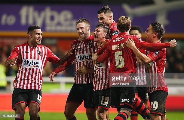Lee Holmes of Exeter City celebrates after scoring the second during the Emirates FA Cup third round match between Exeter City and Liverpool at St...