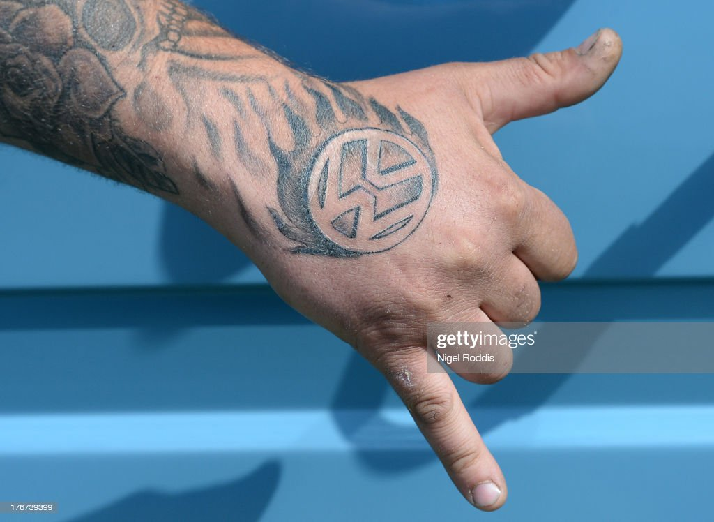 Lee Horton of Pontefract poses with his VW tattoo during the In Praise Of All Things VW At The Annual Festiva at Harewood Housel on August 18, 2013 in Leeds, Yorkshire. The annual VW festival in its 9th year attracts around 15,000 people over the weekend, ending with the winners car parade on Sunday.
