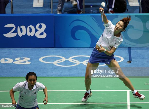 Lee Hyojung and Lee Kyungwon of Korea play against Jiang Yanmei and Li Yujia of Singapore during their women's doubles quarter final badminton match...