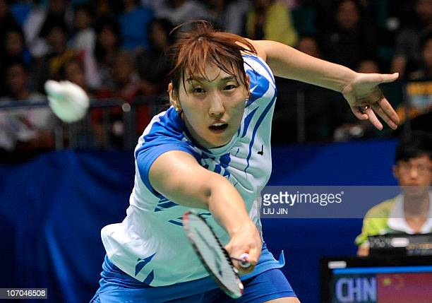 Lee HyoJung returns a shot with her parnter Shin BaekCheol of South Korea against Zhang Nan and Zhao Yunlei of China during their mixed doubles...