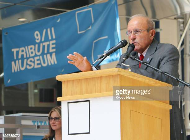 Lee Ielpi who lost his firefighter son in the Sept 11 terror attacks addresses a ceremony in New York on June 13 to celebrate the completion of the...
