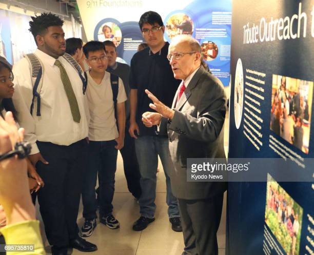 Lee Ielpi who lost his firefighter son in the Sept 11 terror attacks explains about exhibitions at the 9/11 Tribute Museum in New York on June 13...