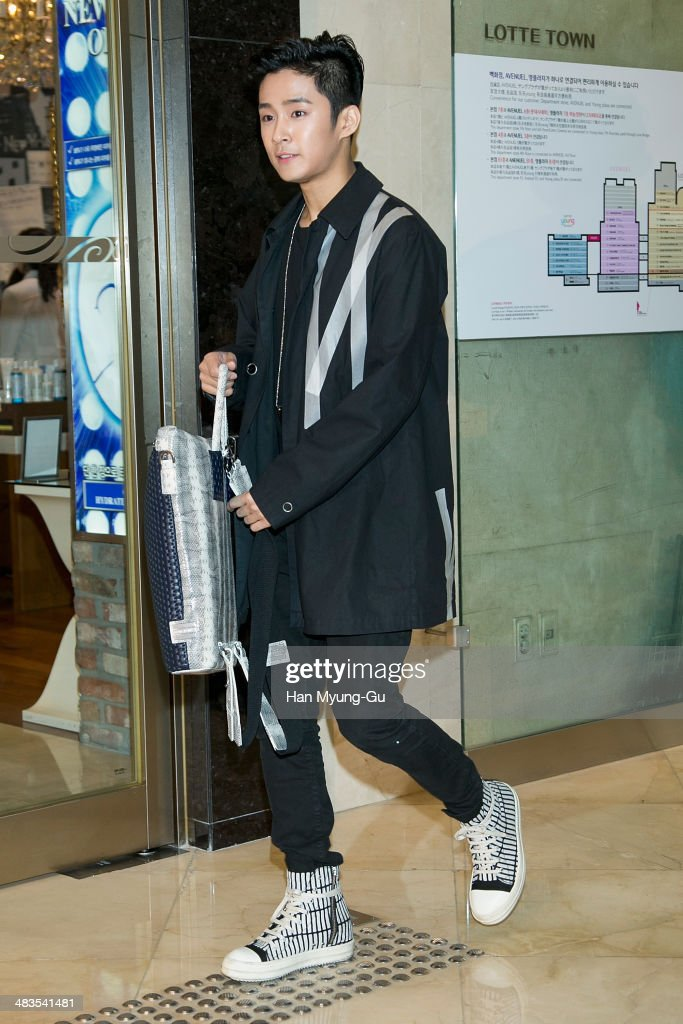Lee Jae-Jin (bag detail) of South Korean boy band FTisland attends the 'Helianthus' 2014 S/S Lesley Line Launch event at Lotte Department Store on April 9, 2014 in Seoul, South Korea.