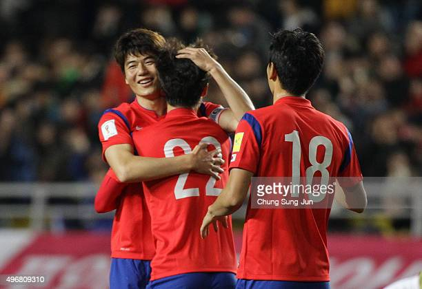 Lee JaeSung of South Korea celebrates after a score with Ki SungYueng during the 2018 FIFA World Cup Qualifier Round 2 Group G match between South...