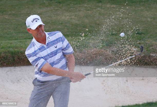Lee Janzen hits out of the sand trap on the 18th green during the final round of the Mitsubishi Electric Classic tournament at the TPC Sugarloaf Golf...