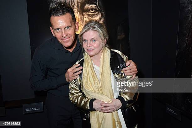 Lee Jeffries and Isabelle Nanty attend the Lee Jeffries Photo Exhibition Preview At Galerie Pompidou Yellow Korner on March 19 2014 in Paris France