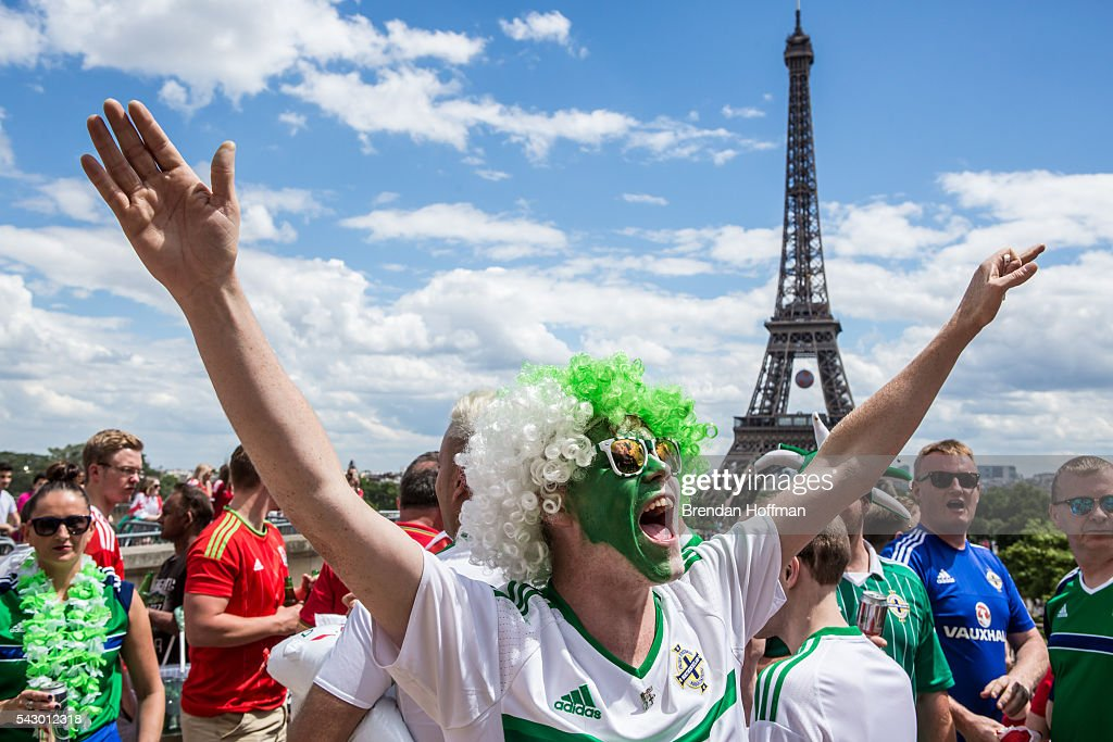 Lee Jenkinson, from Portadown, Northern Ireland, celebrates near the Eiffel Tower before the football match between Wales and Northern Ireland during UEFA Euro 2016 tournament on June 25, 2016 in Paris, France. Wales edged Northern Ireland in the Round of 16 at Parc des Princes in Paris.