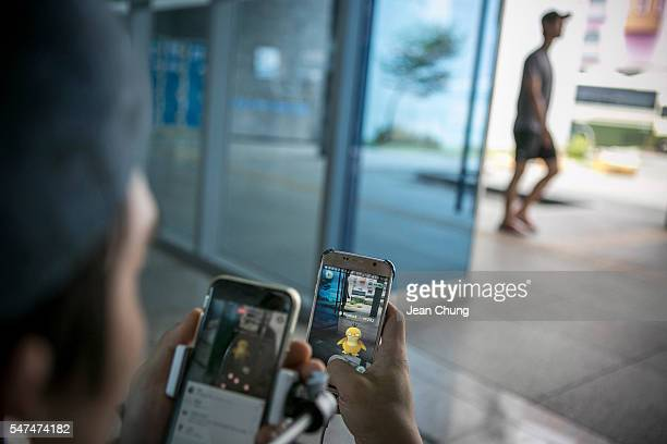 Lee Jeonghwan broadcasting jockey for Pokemon Go Korea Facebook page broadcasts live as he plays the game at the Express Bus Terminal on July 15 2016...