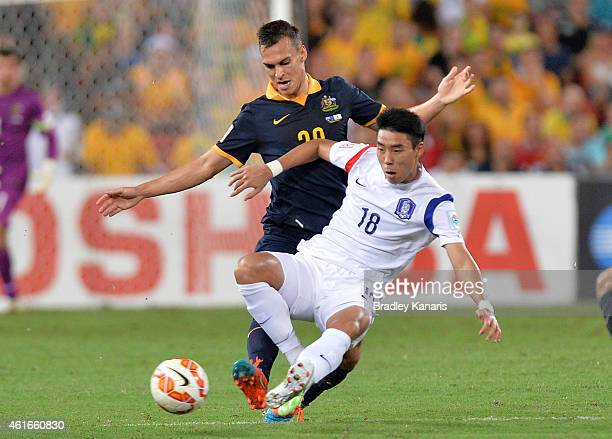 Lee Jeonghyeop of Korea Republic is challenged by Trent Sainsbury of Australia during the 2015 Asian Cup match between Australia and Korea Republic...